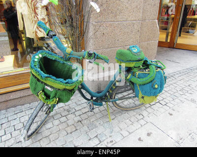 This bike was parked on a sidewalk in front of a store in Copenhagen, Denmark, in March 2013. Almost every section - Stock Photo