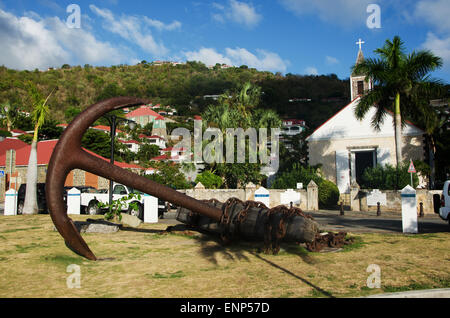 Saint-Barthélemy, French West Indies, Caribbean: a sculpture in the form of an anchor, the skyline of Gustavia and - Stock Photo