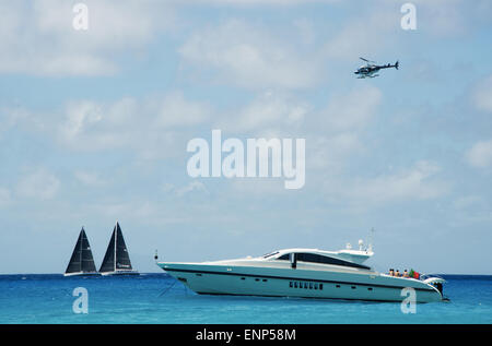 Saint-Barthélemy, French West Indies, French Antilles: a motorboat in the Caribbean Sea and the sailboats during - Stock Photo