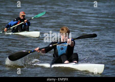 Competitors racing in a K1 racing kayaks - Stock Photo