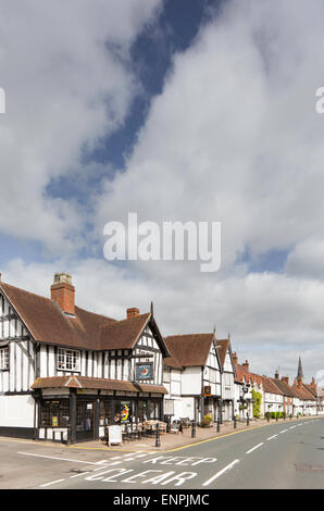 Cafe and ice cream parlour timber frames cottages line the high street in Henley in Arden, Warwickshire, England, - Stock Photo
