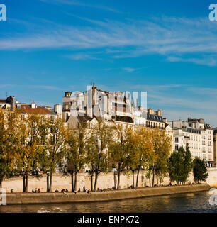 Ile Saint-Louis on an autumn day with Seine River in the foreground. - Stock Photo