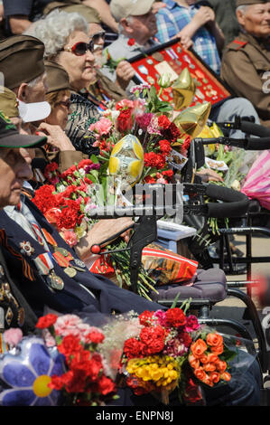 Toronto, Canada. 9th May 2015. War veterans sit for official part of Ceremonial Parade for 70 years anniversary - Stock Photo