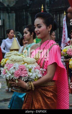 Offering flowers during the Khmer New Year in Angkor Wat, Siem Reap - Stock Photo