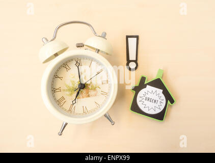White Clock with Alert and Urgent Sign - Stock Photo