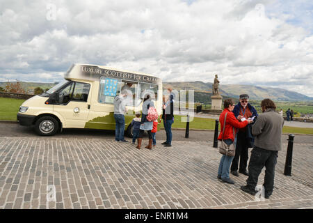 Ice cream van and tourists outside Stirling Castle with the Robert the Bruce statue and Wallace Monument behind