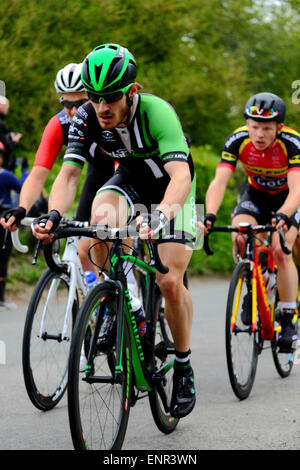 Team Wiggins' is one of eleven pro-cycling teams racing through south Wiltshire Cycle Wiltshire Grand Prix' with - Stock Photo