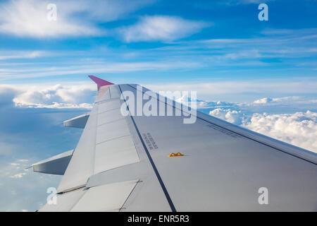 Looking through window aircraft during flight. - Stock Photo