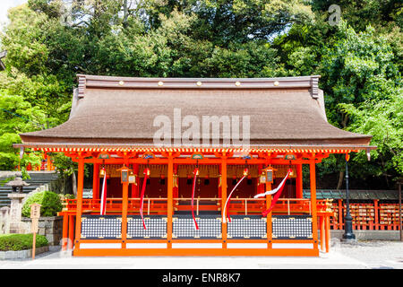 Japan, Kyoto, Fushimi Inari-Taisha Shinto shrine. Small sub shrine, Hall with bells, suzu - Stock Photo