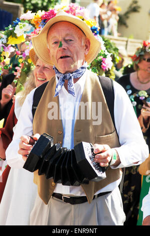 Man in costume play instrument during the carnival - Stock Photo