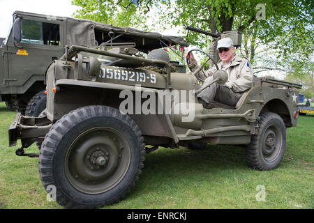 London, UK. 10th May, 2015. The day after the Allies commemerated VE Day, Charles SIlverlight sits behind the wheel - Stock Photo