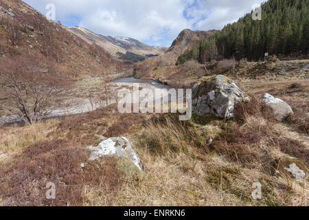 Scenic photo of Scottish Highlands, with a river or stream and stones in the foreground. - Stock Photo