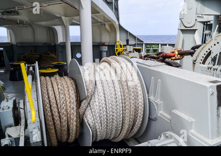 Bow of a cargo ship and mooring lines - Stock Photo