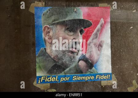 Poster of Fidel Castro in window of abandoned building, Havana, Cuba - Stock Photo