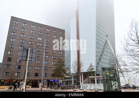 Morning fog in Rotterdam (Kop van Zuid, KPN tower) Erasmusbrug / Wilhelminaplein, the Netherlands - Stock Photo