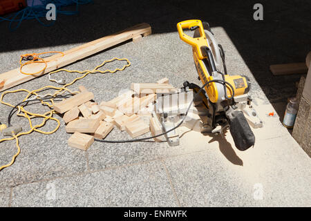 Miter saw at construction site - USA - Stock Photo