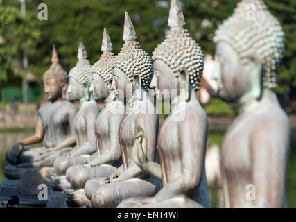 Buddha Statues at Seema Malakaya Meditation Centre, Colombo, Sri Lanka - Stock Photo