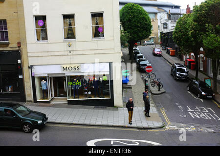 Looking down at pedestrians waiting by a shop along Park Street in Bristol. - Stock Photo
