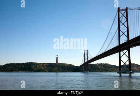 Ponte 25 De Abril bridge over River Tagus with View of Cristo Rei in Almada  in Lisbon - Portugal - Stock Photo