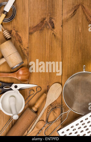 A selection of Kitchen Utensils on a farmhouse kitchen table - with Space for Text - Stock Photo