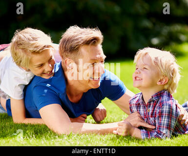 Father playing with is children outdoors - Stock Photo