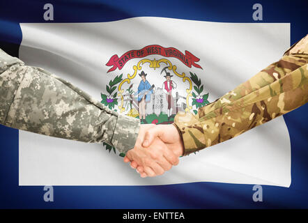 Soldiers handshake and US state flag - West Virginia - Stock Photo