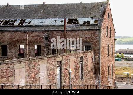 View at back of the 1836 derelict William Halley & Sons Ltd Jute Mill which is a Listed Building in Dundee,UK - Stock Photo