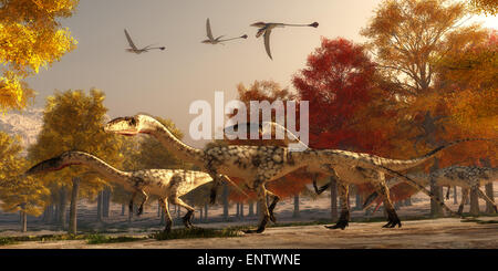 Three flying Eudimorphodons pass a group of Coelophysis hunting for prey through a forest of autumn trees in the - Stock Photo