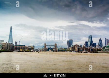 View towards Tower Bridge along the Thames river from East London. - Stock Photo