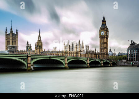 Westminster bridge over river Thames with Houses of Parliament and Big Ben in background. London, UK. - Stock Photo