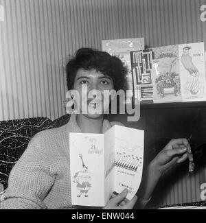 Salford born playwright Shelagh Delaney pictured opening 21st birthday cards at her home in Salford. 25th November - Stock Photo