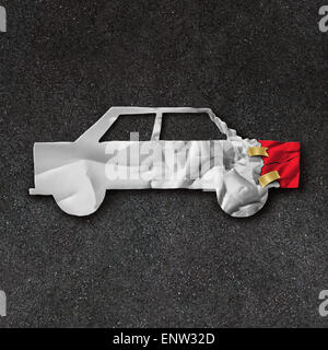 Car repair accident symbol and automobile crash fix concept on an asphalt road with  white crumpled paper shaped - Stock Photo