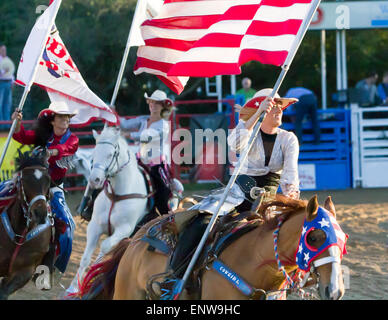 Cowgirl Bearing The Helotes Flag In The Opening Ceremony