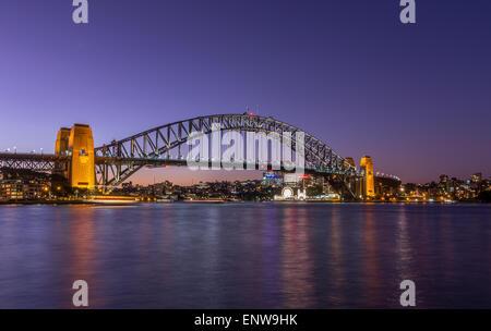 Sydney Harbour Bridge in Sydney Harbour, Sydney, New South Wales, Australia at sunset - Stock Photo