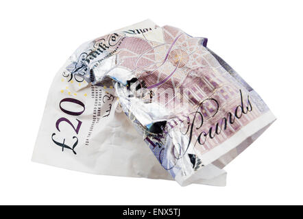 British Sterling twenty pound note screwed up on isolated white background. England UK Britain - Stock Photo