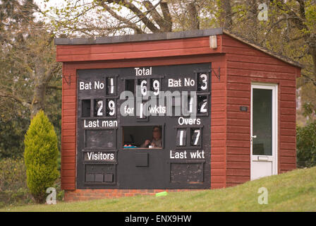 Cricket scorer and board during a local village green match, Liphook, Hampshire, UK. - Stock Photo
