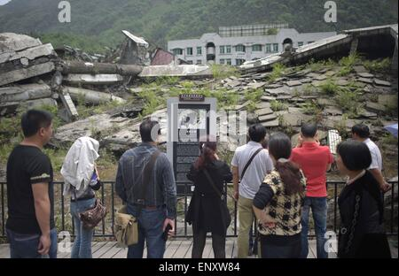 Beichuan, China's Sichuan Province. 12th May, 2015. People visit ruins of Wenchuan Quake in Beichuan County, southwest - Stock Photo