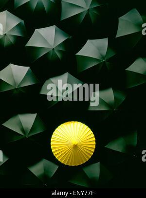 Umbrellas Many black umbrellas and one Yellow umbrella Japanese Chinese Asia - Stock Photo