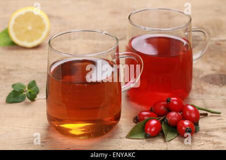 Tee aus Hagebutte und Rooibos - Stock Photo