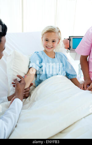 Smiling child patient getting a vaccinate - Stock Photo