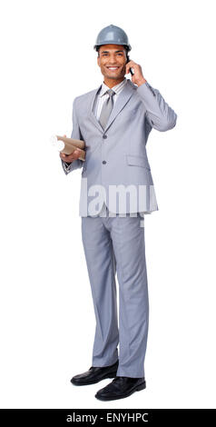 Young Architect on phone carrying blueprints isolated on a white background - Stock Photo