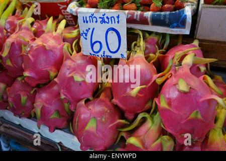 Dragon fruit, pitaya, or pitahaya on a fruit stall in a Bangkok food market, Thailand, February - Stock Photo