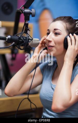 Portrait of a radio host speaking - Stock Photo