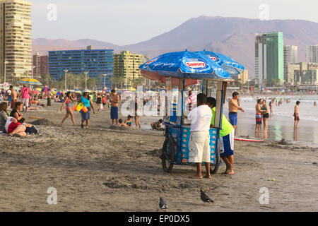 Ice cream cart on the sandy Cavancha beach in Iquique, Chile - Stock Photo