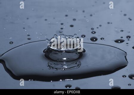 Water drop splash in crown shape - Stock Photo