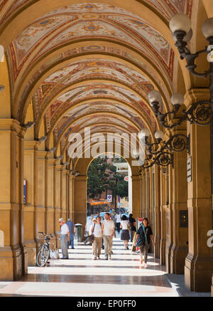 Bologna, Emilia-Romagna, Italy. The shopping arcade in Piazza Cavour. - Stock Photo