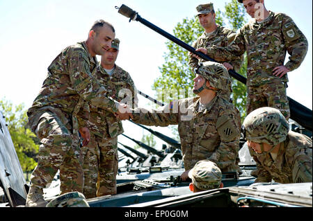 A Georgian soldier greets U.S. Army soldiers from the 3rd Infantry Division after arriving for exercise Noble Partner - Stock Photo