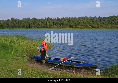 Canoe on the lake. - Stock Photo