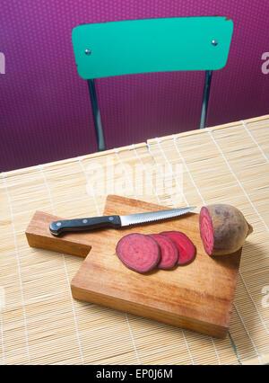 Vegan Salami, joking slices of red beet - Stock Photo