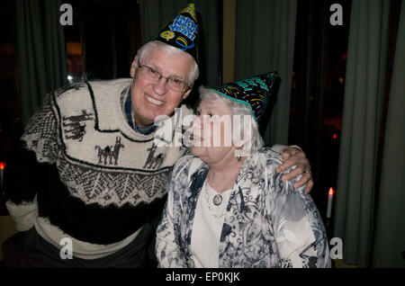 Senior couple New Years Eve revelers in their late 70's. St Paul Minnesota MN USA